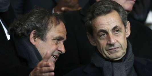 Michel Platini et Nicolas Sarkozy, en février 2015.