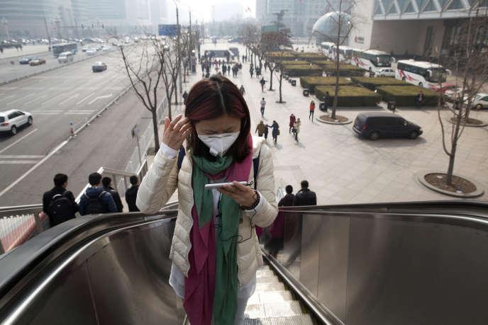 Dans une rue de Pékin, le 7 mars.