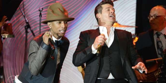 Pharrell Williams (à gauche) et Robin Thicke (au centre) ont été condamnés pour avoir plagié une chanson de Marvin Gaye.