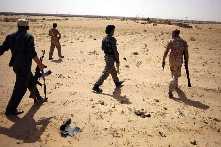 Des membres du groupe Aube de la Libye en patrouille près de Syrte, le 17 mars.
