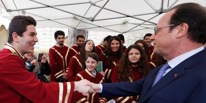 Cérémonie d'accueil de 200 chrétiens venus d'Irak et de Syrie, en présence de François Hollande, le 21 mars 2015 au ministère de l'Intérieur.