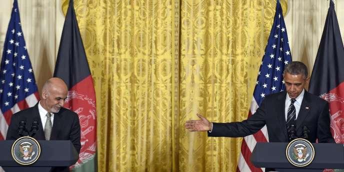 De gauche à droite : le président afghan, Ashraf Ghani, et son homologue américain, Barack Obama, le 24mars, à Washington.