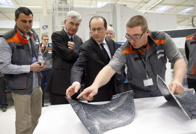 François Hollande et Jean-Paul Herteman, lors de l'inauguration de Safran-Albany, dans l'est de la France, en novembre 2014.