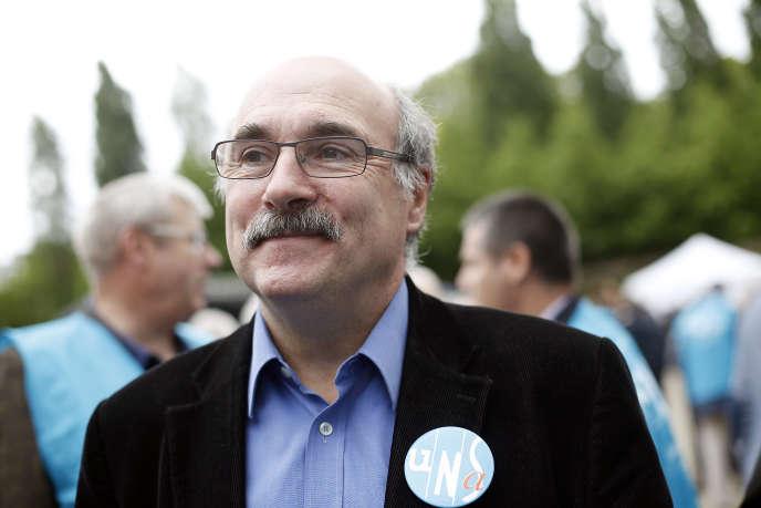 Luc Bérille, le secrétaire général de l'UNSA, le 1er mai 2014 à Paris.