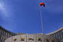 A Chinese national flag flutters in front of the headquarters of the People's Bank of China, China's central bank, in central Beijing, May 16, 2014. The bank is injecting a combined 500 billion yuan ($81.35 billion) of liquidity into the country's top banks, according to media reports, a sign that authorities are stepping up efforts to shore up a faltering economy. Picture taken May 16, 2014. REUTERS/Petar Kujundzic (CHINA - Tags: BUSINESS POLITICS) - RTR46JCM