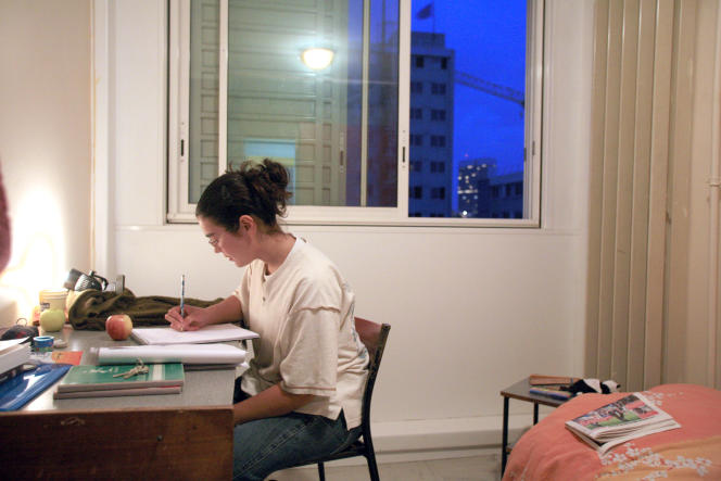 A student works in her room in Nanterre University's student housing, 09 October 2007 in Nanterre, a suburb of Paris, on the first day of the academic year. AFP PHOTO MARC WATTRELOT