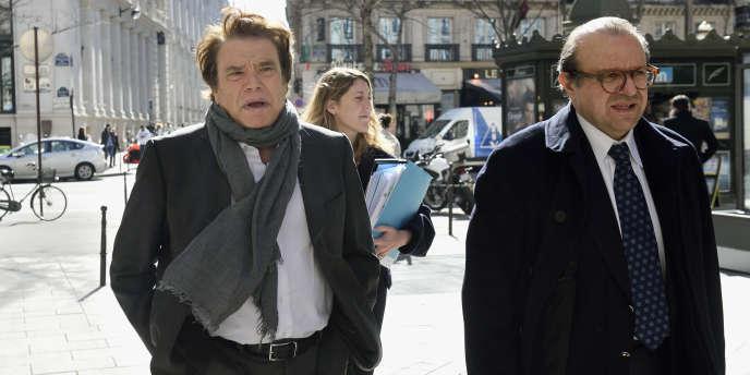Bernard Tapie peu avant son audition parr les juges financiers chargés de l'enquête sur l'arbitrage controversé, le 12 mars à Paris.