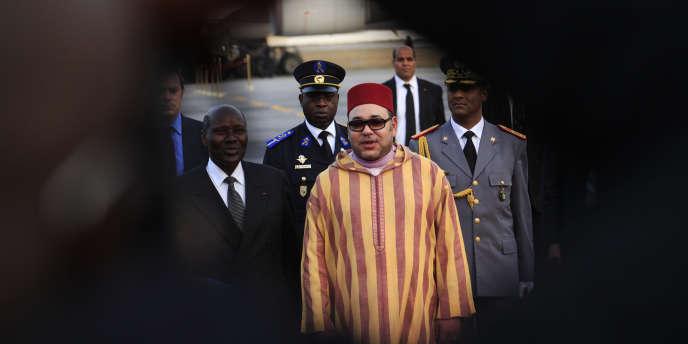 Mohammed VI lors d'une visite à Abidjan, le 23 février 2014.