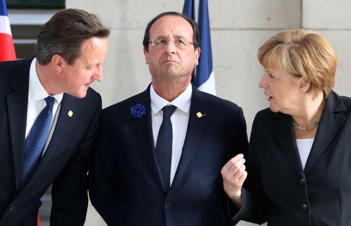 David Cameron, François Hollande et Angela Merkel lors de commémorations de la première guerre mondiale à Ypres (Belgique) en juin 2014.