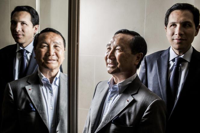 Chuc Hoang avec son fils Nicolas, à Paris, le 25 juin 2014.