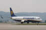 FILE - In this Wednesday, May 13, 2015 file photo, a Ryanair plane lands at the Marseille Provence airport, in Marignane, southern France. Europe's leading budget airline Ryanair said Tuesday May 26, 2015 they have beaten forecasts again, reporting full-year net profits of 867 million euros ($949 million), 66 percent higher than the year before.  (AP Photo/Claude Paris, File)