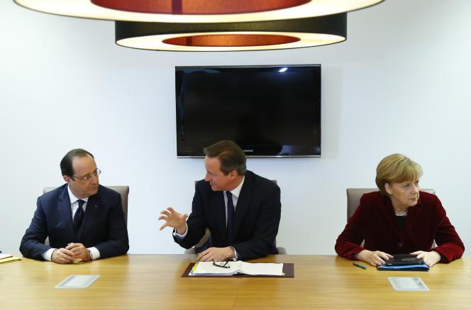 Le président français François Hollande, le premier ministre britannique David Cameron et la chancelière allemande Angela Merkel, en mars 2014, à Bruxelles.