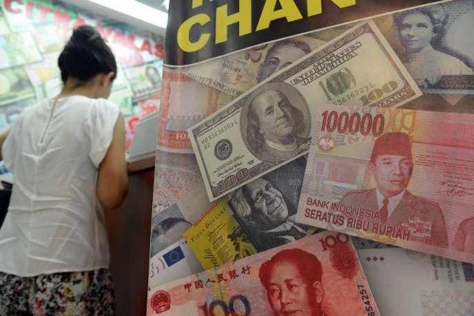 US dollar, rupiah d'Indonésie et  renminbi chinois.