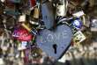 """Padlocks attached by lovers are seen on the fence of the Pont des Arts over the River Seine in Paris, France in this February 13, 2014 file photo on the eve of Valentine's Day.   REUTERS/Charles Platiau/Files  FROM THE FILES PACKAGE """"PADLOCKS OF LOVE"""" SEARCH """"PADLOCKS OF LOVE"""" FOR ALL 14 PICTURES"""