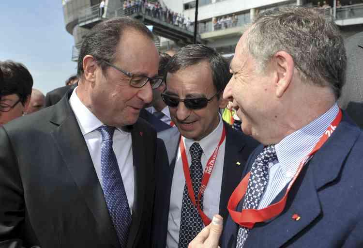 """Le Mans, 13 juin 2015. François Hollande, Pierre Fillon, président de l'Automobile Club de l'Ouest, et Jean Todt. """"La première personne qui à suggéré à François Hollande d'aller au Mans, c'est son ministre de l'agriculture, Stéphane Le Foll. Lorsque je le rencontre à l'Elysée en mai, après ma nomination par Ban Ki-moon comme ambassadeur de la sécurité routière pour l'ONU, je lui dis : vous devriez venir au Mans."""" Jean Todt a su convaincre."""