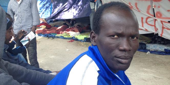 Un migrant, au campement rue d'Eole, samedi 13 juin.