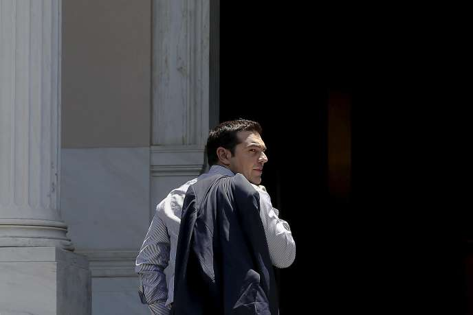 Greek Prime Minister Alexis Tsipras looks on as he arrives at this office at Maximos Mansion in Athens June 20, 2015. Greece will try to bring more to the table in negotiations for a debt deal and Tsipras will probably speak with European Commission chief Jean-Claude Juncker by phone on Saturday to try to end the deadlock, a Greek minister said. REUTERS/Alkis Konstantinidis