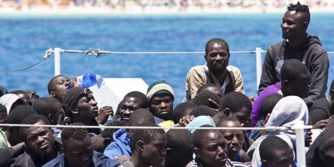 Des migrants à Lampedusa en Italie le 23 juin.