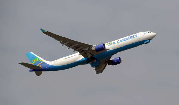 An Air Caraibes Airbus A330-300 takes off from Paris-Orly airport on March 26, 2013.   AFP PHOTO / ERIC PIERMONT