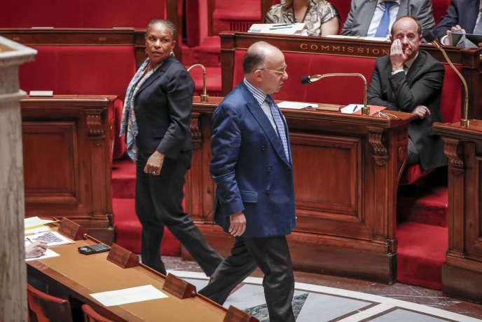 Christiane Taubira, Bernard Cazeneuve et Jean-Jacques Urvoas, rapporteur du texte sur le renseignement, à l'Assemblée nationale, le 24juin.