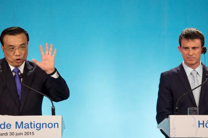 Le premier ministre chinois Li Keqiang (à gauche) et Manuel Valls (à droite), à Matignon, le 30 juin.