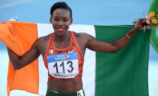 Murielle Ahouré célèbre sa victoire au 200 m lors des championnats d'Afrique d'athlétisme à Marrakech en août 2014.