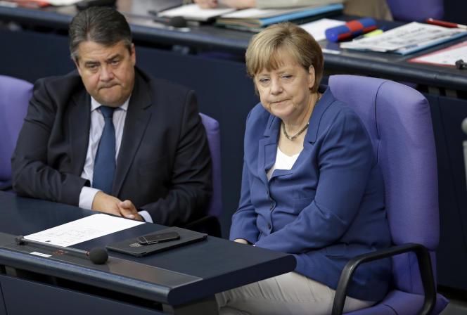 Sigmar Gabriel au côté de Angela Merkel, le 3 juillet à Berlin.