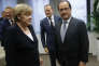 La chancelière allemande, Angela Merkel, et François Hollande, lors d'un sommet de la zone euro sur la Grèce, le 7 juillet, à Bruxelles.