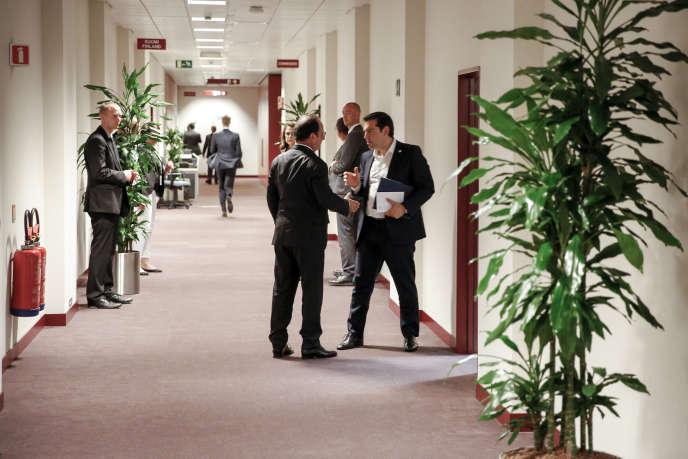 Aparté entre François Hollande et Alexis Tsipras, mardi 7juillet, à Bruxelles.