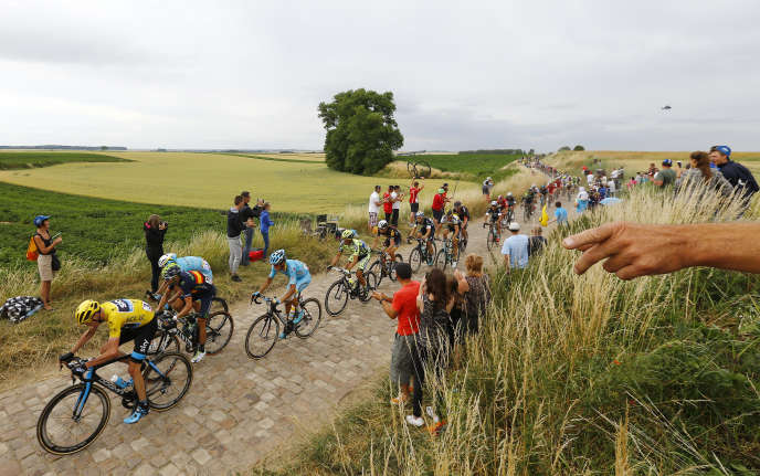 The peloton as it cycles on a cobble-stoned section of the 4th stage of the 2015 Tour de France.