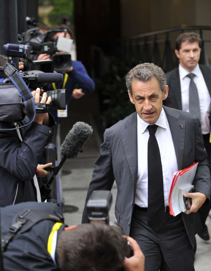 Former French President and President of French right-wing opposition party Les Republicains Nicolas Sarkozy arrives for a meeting of European Popular Parties (EPP), on July 12, 2015, in Brussels, on the sidelines of talks on the Greek crisis. AFP PHOTO / JEAN-CHRISTOPHE VERHAEGEN
