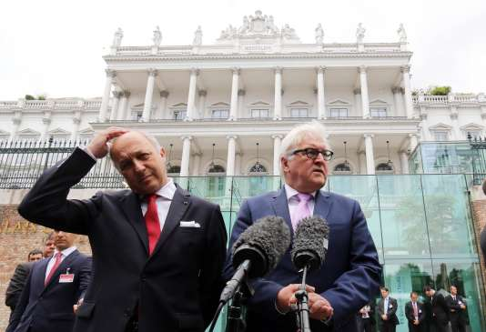 Le ministre français des affaires étrangères Laurent Fabius et son homologue allemand, Frank-Walter Steinmeier, à Vienne le 13 juillet.