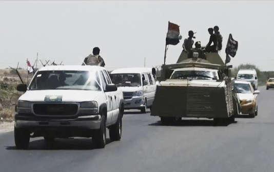 Les forces de sécurité irakiennes se préparent les positions de l'Etat islamique à Fallouja, à65kilomètres de Bagdad, lundi13juillet.