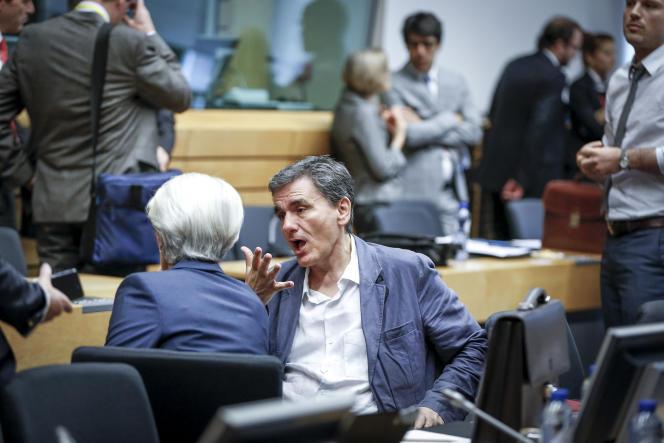 La directrice générale du FMI, Christine Lagarde, et le  ministre des finances grec, Euclide Tsakalotos, participent à une réunion de l'Eurogroupe à Bruxelles, le 12 juillet 2015.