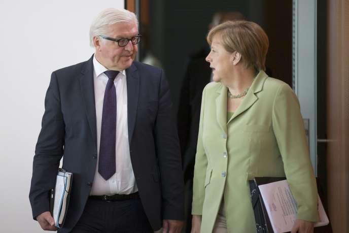 Le ministre allemand des affaires étrangères, Frank-Walter Steinmeier, et la chancelière, Angela Merkel, le 15 juillet.