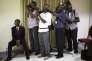Des photographes lors de la présentation des résultats des élections au Comité national électoral à Bujumbura, le 24 juillet.