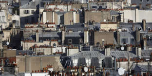 View of Paris rooftops November 30, 2011. While the association of Paris real estate legal notaries have confirmed a progression of prices in the third quarter and a total of 19.1% over the course of 2011, they also noted that a figure less than a 20% annual price increase in the French capital may indicate the end of record real estate highs. REUTERS/Mal Langsdon (FRANCE - Tags: CITYSCAPE BUSINESS REAL ESTATE) - RTR2UNC0