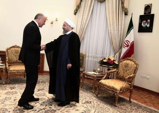 Le ministre français des affaires étrangères Laurent Fabius et le président iranien Hassan Rohani.