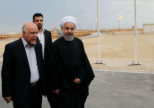 Le président iranien, Hassan Rohani, avec son ministre du pétrole, le 17 mars.