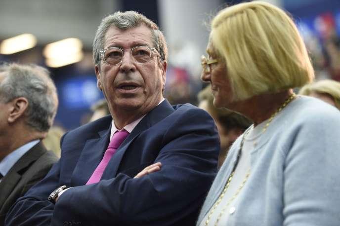 Le maire de Levallois-Perret, Patrick Balkany, et sa femme, Isabelle Balkany, lors d'un meeting de l'UMP à Boulogne-Billancourt en novembre 2014.