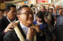 Sam Rainsy, foreground, leader of the opposition Cambodia National Rescue Party (CNRP), receives a garland of jasmine upon his arrival at Phnom Penh International Airport in Phnom Penh, Cambodia, Sunday, Aug. 16, 2015. Hundreds of cheering supporters greeted Sam Rainsy on his return from a trip abroad, at a time of the arrest of his senator Hong Sok Hour. Hong Sok Hour was arrested two days after Prime Minister Hun Sen accused him of treason for comments posted on Facebook. (AP Photo/Heng Sinith)