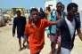 Des migrants arrivent à Ben Gardane (Tunisie), après avoir été secourus en mer par les garde-côtes Tunisiens, le 23 août.
