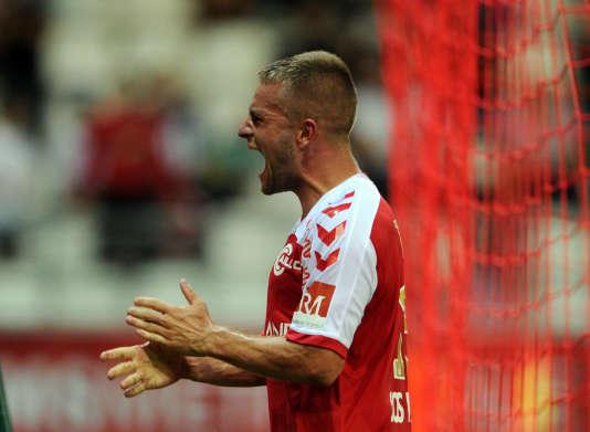 Atila Turan exulte après son but, le troisième pour le Stade de Reims.