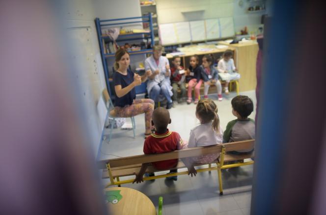 Ecole maternelle Merlin, à Paris. AFP PHOTO / LIONEL BONAVENTURE