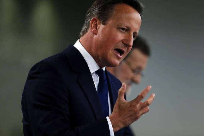 Le premier ministre britannique, David Cameron, lors d'une conférence de presse avec Mariano Rajoy, chef du gouvernement espagnol, à Madrid, vendredi 4 septembre.