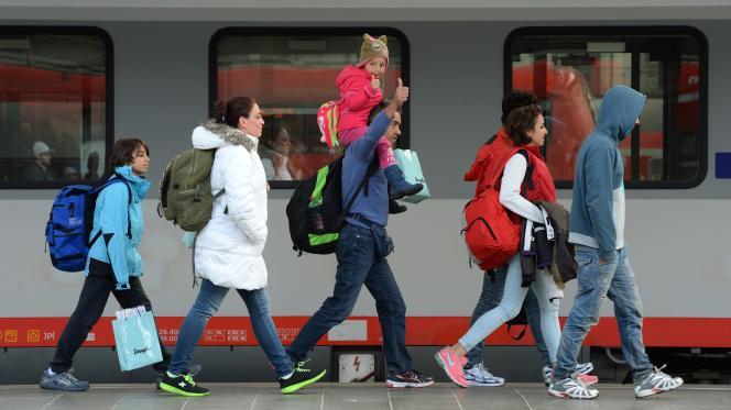 Des migrants à la gare de Munich en Allemagne le 6 septembre 2015. -