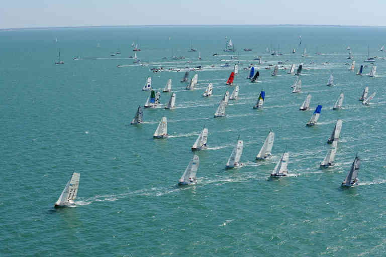 Competitors take the start of the Mini Transat sailing race, from La Rochelle to Salvador Do Bahia in Brazil, on their monuhull Depart de la mini transat 6,50 Charente-Maritime Bahia. La Rochelle, September 13, 2009.  AFP PHOTO XAVIER LEOTY