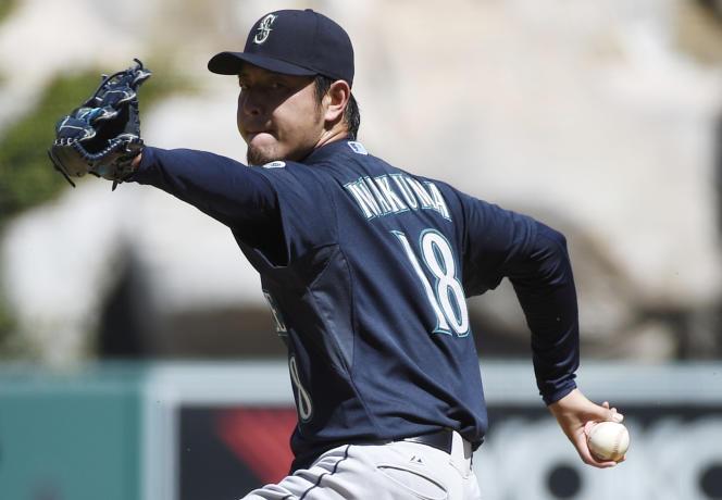 Le retour du baseball et du softball aux jeux-2020 rapporterait 50 millions de dollars supplémentaires en ventes de billets. Ici, Hisashi Iwakuma, pitcher des Seattle Mariners, le 27 septembre.