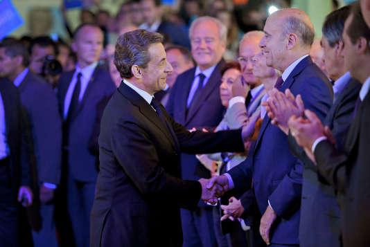 Nicolas Sarkozy et Alain Juppé au meeting de Valérie Pécresse pour les élections régionales, à Nogent-sur-Marne (Val-de-Marne) le 27 septembre.