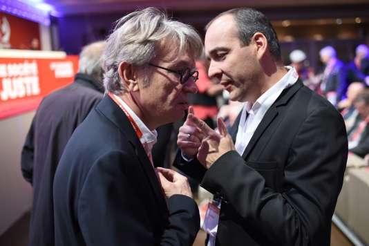 Jean-Claude Mailly (FO) et Laurent Berger (CFDT), lundi 19 octobre, au palais Iéna pour la conférence sociale.